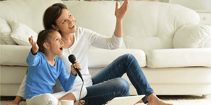 Woman singing with daughter